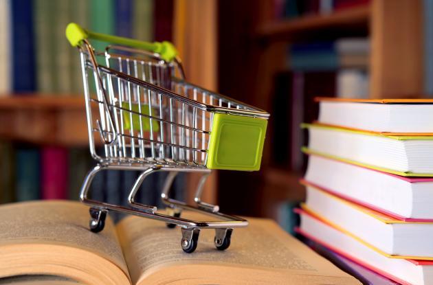Miniature shopping cart on book
