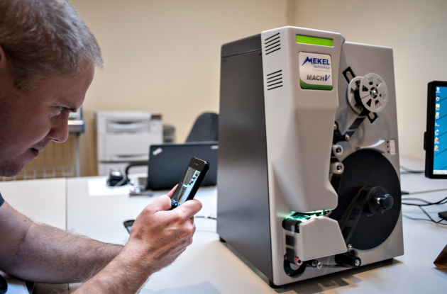 Avis Microfilm reader is photographed with a mobile phone