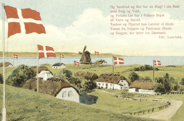 Dannebrog waves over a fjord landscape in southern Jutland