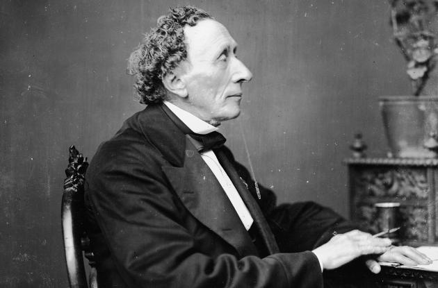 Hans Christian Andersen at his desk