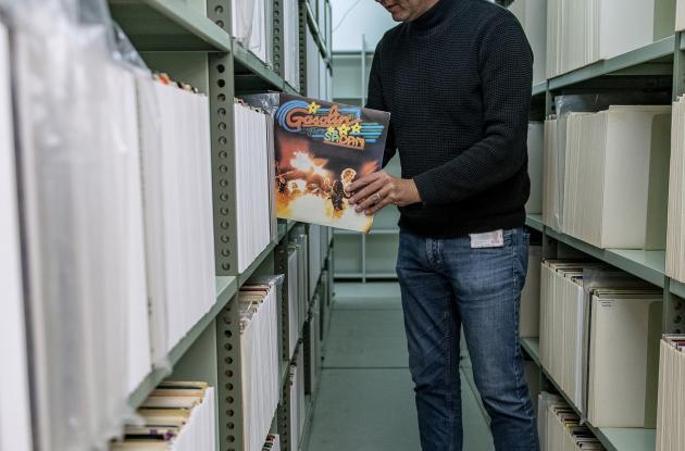 Employee between shelves with vinyl records