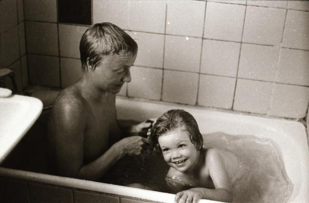 Child and woman in bathtub