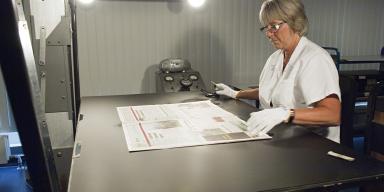 Employee photographs newspaper