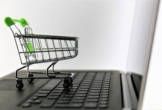 Miniature shopping cart on lapstop