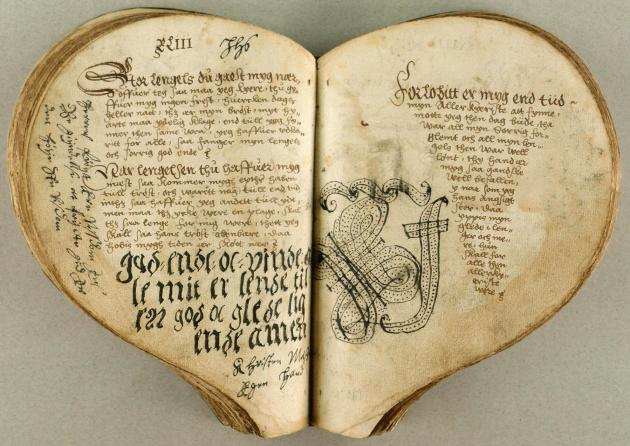 Heart-shaped book with handwriting