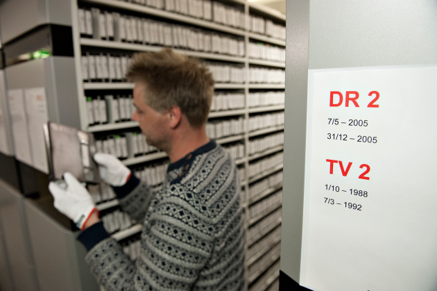 Employee between shelves in the Radio Tv Collection