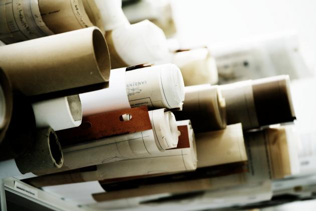 Rolled up architectural drawings on shelf