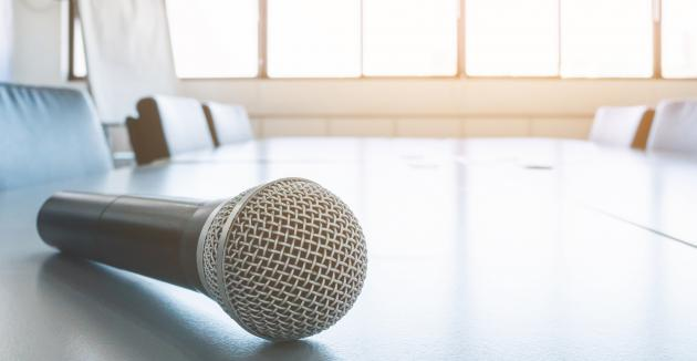 Microphone on table in meeting room