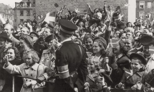 The Liberation 1945: Crowd and Danish police with freedom fighter armband at Christiansborg Castle Square, May 1945