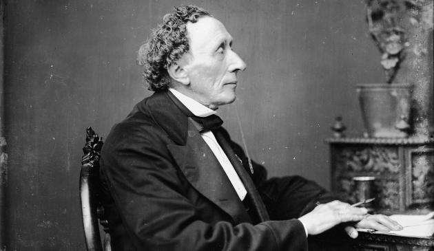 Hans Christian Andersen at his desk